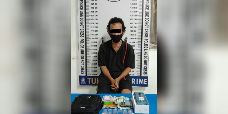 Maidin, 45 tahun, pria yang diringkus polisi dari Jalan Dalil Tani, Kelurahan Tomuan, Selasa (15/12) malam.